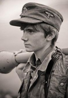 Young German holding Panzerfaust, one of the first anti-tank weapons which took great bravery to use