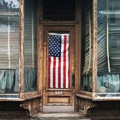 Flag proudly displayed on an old weathered store front