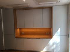 mobiliario #SANTOS modelo INTRA en laminado seda con un frigorifico integrado y combinando un sobre de roble macizo. by smstudio.  #santos  #kitchenbarcelona #mueblessantos  #santoscocinas #smstudi