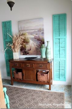 Aqua shutters, natural grasses, seagrass baskets.