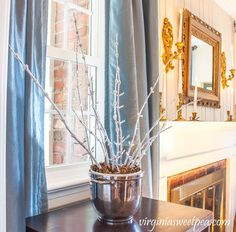 After Christmas was stored away, it was time to decorate my home for winter. I made DIY frosted branches to use for winter decor and I love how these branches look in my home. This is a simple project that is easy to make and it can be saved to use from year to year. It gets bonus points because it is super inexpensive to make!