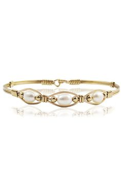 """The """"Bella"""" is a beautiful bracelet made from 14k Gold Artist Wire featuring three separate windows with a pearl in each window. The word Bella means Beautiful girl. The Bella in your life could be your mother, daughter or granddaughter and is a perfect gift for that someone special in your life."""