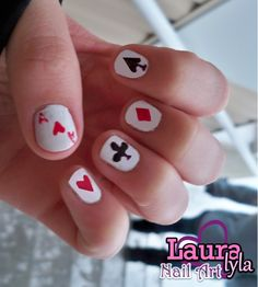 Playing Card Nails :)  http://www.youtube.com/user/lauralyla?feature=mhee