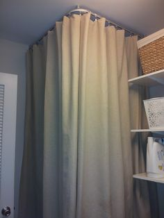 Found a way to hide our water heater- Kvartal ceiling mounted curtain track from Ikea!