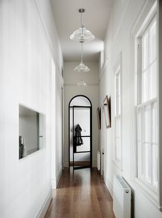 This view shows how the steel-framed glass was elegantly melded with historic architectural details like the arched hallway opening. Tagged: Hallway and Medium Hardwood Floor. Photo 5 of 10 in Light Floods This Dazzling Renovated Victorian in Australia. Modern Hallway, Entry Hallway, Victorian Terrace, Victorian Homes, Victorian Interiors, Modern Interiors, Hallway Designs, Hallway Ideas, Classic Building