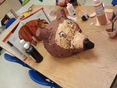 Brown bear paper mache...   We used a balloon for the head, top of a 2 liter soda bottle for the nose, and 2 plastic cups for the ears... the kids loved it!!!! and so did I :)