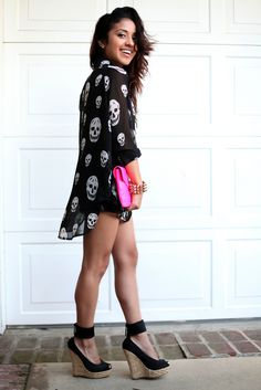 So much swag. Leather shorts underneath. Killer wedges, & and a flowing shirt so comfy and sexy at the same time