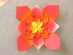 Origami Hydrangea by Shuzo Fujimoto Video Tutorial. The center of this flower is complex and beautiful, which is difficult to see in the pix.