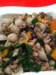 Brown rice shell pasta.. Ground turkey, chopped mushroom, cannelloni beans, orange peppers, and spinach - fresh parsley, garlic and basil with salt free all purpose seasoning and balsamic vinegar