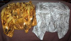 These are my two shawls by Alexander McQueen. The Gold Angels shawl, on the left is 100% silk (bought on sale from zappos.com, and from Lee Alexander McQueen's final collection), while the (name needed) shawl on the right is made of cashmere and silk, and was purchased on eBay.