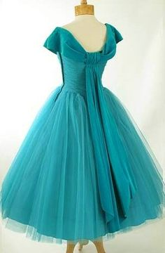 1950's Turquoise Chiffon Dress - The shade of this dress and the ribbon down the back are amazing. I'm really excited about the movement in this design. More