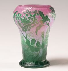 "Daum Nancy 1900 Paris Exposition vase; green over white and pink with acid etched and martele surface. Etched, carved and fire polished floral design moving up from clover ground cover to varied fern stems. 6 1/4""H. Engraved signature and Paris Expo paper label on base."