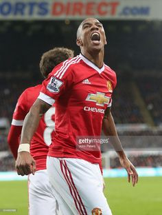 Ashley Young of Manchester United celebrates Wayne Rooney scoring their third goal during the Barclays Premier League match between Newcastle United and Manchester United at St James' Park on 12 January 2016 in Newcastle Upon Tyne, England.