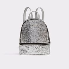 Tragole With eye-catching glitter finish and silver zippers, this backpack is perfectly sized for an overnight stay or a long commute. Silver Backpacks, Aldo Shoes, Fashion Backpack, Fashion Shoes, Glitter, Purses, Bags, Accessories, Things To Sell