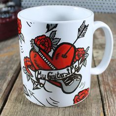 "Guitar Heart Mug:  For the guitar-lovers of this world.  Or lovers of the guitar lovers.  Your guitar heart splattered all over a coffee mug.  ""My Guitar and Me"" is the title of a song by guitar hero Hubert Sumlin by the way.  Check him out if you don't already know of him."