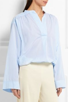 Sky-blue cotton-poplin Button fastening at front 100% cotton Hand wash Imported