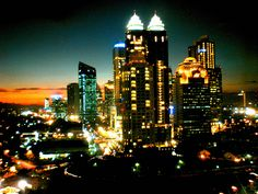 it's the way the sunset sparkles and still steals the attention from the lights. Jakarta, Indonesia