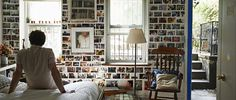 'Our creative small apartment': We love Brooklyn couple Laurie and Garette's picture wall. It lokos like a brick wall from a distance but up close you see it's hundreds of photos. | live from IKEA FAMILY