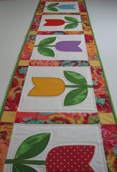 Quilted Table Runner--Appliqued Tulips, Spring Table Runner, Easter Table Runner by VillageQuilts on Etsy Tablerunners, Patchwork Table Runner, Table Runner And Placemats, Quilted Table Runners, Quilted Table Runner Patterns, Easter Table, Easter Placemats, Yellow Turquoise, Purple Yellow