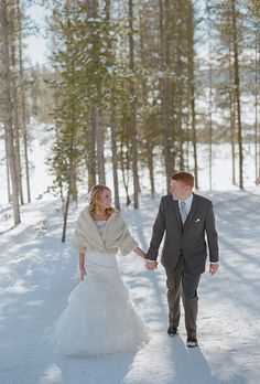 Snow is a great backdrop for wedding portraits | @lauramurray | Brides.com
