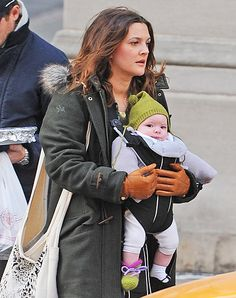 Drew Barrymore's baby, Olive, knows that the warmest place to be in frigid NYC is snuggled right up against mom!