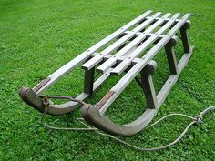 Traditional vintage Davos wooden sledge with metal frame and metal runners