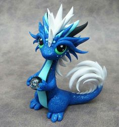 My next sale's theme is dragons with pets, and so far this little guy is my favorite. Dragon with Ball Python Polymer Clay Kunst, Polymer Clay Dragon, Polymer Clay Figures, Polymer Clay Animals, Cute Polymer Clay, Cute Clay, Polymer Clay Projects, Polymer Clay Creations, Dragons