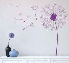 This stunning floral wall art sticker is perfect for the family entrance, living room, hall, bedroom or any room in your house. These dandelion flower decals can be any colour and any size to suit your home, send us an email if you would like a different size that we don't currently offer.  Our stickers are precision cut from high quality matt finished ultra-thin vinyl, they look absolutely stunning & appear as though they are painted onto the surface. They come in a variety of colours…