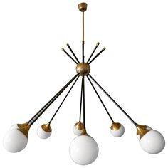 Italian Stilnovo Sputnik Chandelier | From a unique collection of antique and modern chandeliers and pendants  at https://www.1stdibs.com/furniture/lighting/chandeliers-pendant-lights/