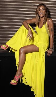 Eve flaunts her stuff in a DKNY dress and Dior heels