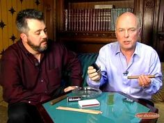 Executive editor Gordon Mott and senior editor David Savona demonstrate the proper methods to light a cigar with either a lighter, matches or cedar spill.