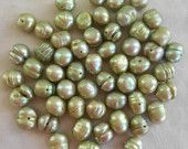 55 Baroque Fresh Water Pearls, 8mm x 7mm light olive green irregularly shaped potato pearls for sale at:https://www.etsy.com/listing/197783242/55-baroque-fresh-water-pearls-8mm-x-7mm?ref=shop_home_active_9