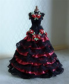 Romantic black and red ruffle ballgown in satin and lace with train. Adorned with embroidered rose buds with genuine swarovski crystal centres.Lovingly created on a 5 inch quality dainty mannequin.