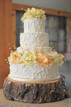 White, pale yellow, and peach wedding cake on a rustic wood slab cake stand | Rustic Cake Stand