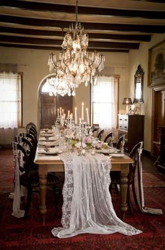 Lace Draped King's Table under Crystal Chandeliers | Joanne Markland Photography on @SouthBoundBride via @aislesociety