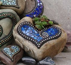 Mosaic Garden Stones with laja and leftover broken talavera.  put into succulent garden as steps