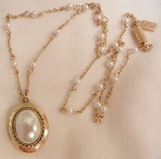 Plaza shop only Memorial 4 day sale 10% off storewide discount taken at purchase or refunded ends 5/28 at midnight. visit my Ruby Lane Shop for more great vintage finds. Shops link on each ones home pages.   Beautiful simulated pearl Locket Necklace 1928 hang Tag