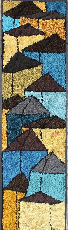 Teal town by Deanne Fitzpatrick. Rug hooking houses of blue,  yellow and green tones.