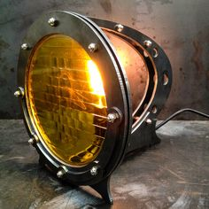 Captain Nemo and the crew of the Nautilus should have had this on their deep sea adventures but unfortunately we werent born yet. As I boy I was fascinated with science fiction so this lamp comes from those early impressions. As with all our pieces this piece of functional sculpture