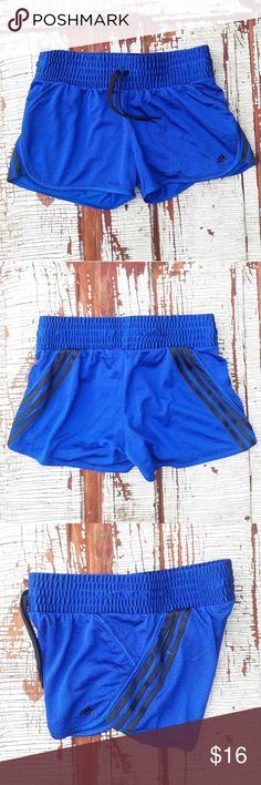 """Adidas blue running shorts 3 black stripes med Women's Adidas royal blue mesh running shorts with 3 black stripes down the sides. Wide elastic waist (for extra comfort) and drawstring  Waist-14.5"""" Rise-9.5"""" Inseam-3"""" adidas Shorts"""