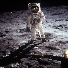 """Apollo 11 — First Men on the Moon    Buzz Aldrin stands near the leg of the Lunar Module (LM) """"Eagle"""" during the Apollo 11 extravehicular activity (EVA). Apollo 11 launched from Cape Kennedy on July 16, 1969, carrying Armstrong, Aldrin, and Command Module Pilot Michael Collins. Armstrong and Aldrin forever changed the course of history by walking on the face of the moon."""