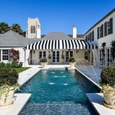 This is exactly what I want! Rectangular pool with water spouts on the side and white patio all around