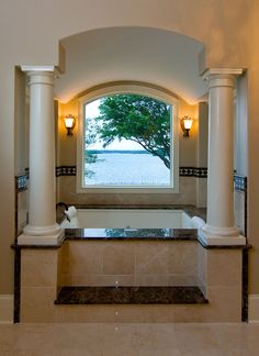 Tub in the master bath of the Heatherstone plan 5016 www.dongardner.com - With its masterful architecture and lavish conveniences, The Heatherstone captures the essence of grand living, blending style and grace. #Bath #Columns #Tile