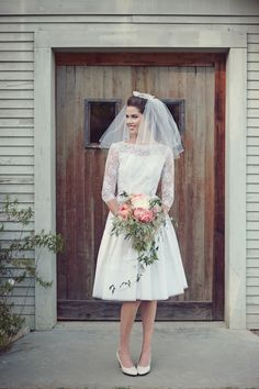 love this vintage wedding dress with lace sleeves + short veil combo!    loving the simple look. IF, and when i get married i'll be doing it in Vegas...and a dress like this would be perfect.