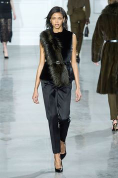 At Jason Wu stoles were styled from right shoulder to left hip, then belted to create a waistline.   - HarpersBAZAAR.com