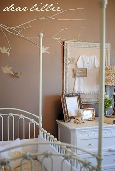 love the tree and the clothes in the frame. cute idea for a nursery
