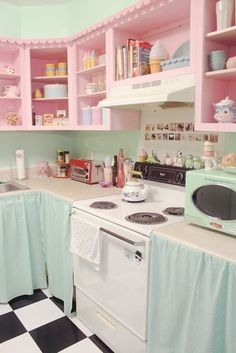 Pastels, no cabinet doors ~ cute solution if you can't afford to redo the cabinet doors.
