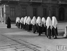 Young nuns on way to mass. Turin, Italy. 1934.