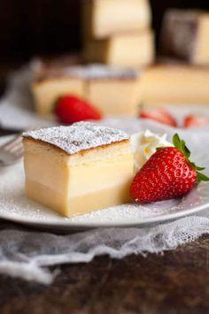 Magic Three Layer Custard Cake with strawberry on a white plate