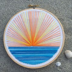 Hand embroidered mountain sunset with a hoop.Russian artist Vera Shimunia creates colorful embroidery designs that look like pieces of landscape art. Using various embroidery stitches, each embroideryBeginner Embroidery- Materials and Tips to Get you Embroidery Flowers Pattern, Simple Embroidery, Hand Embroidery Stitches, Modern Embroidery, Embroidery Hoop Art, Hand Embroidery Designs, Cross Stitch Embroidery, Ribbon Embroidery, Machine Embroidery